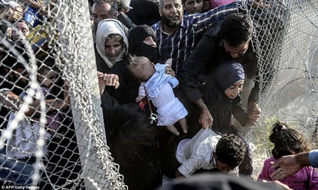 Người tị nạn qua hàng rào